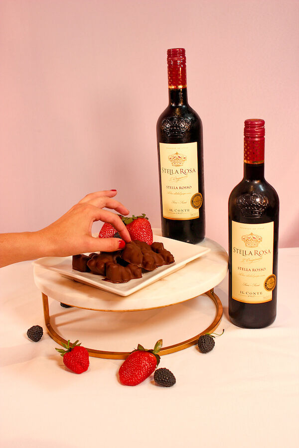 Chocolate covered Rosso infused gummy bears served on a granite cake stand with Stella Rosso.